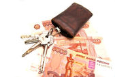 Bunch of keys and banknotes — Stock Photo