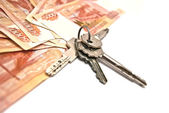 Russian banknotes and house keys — Stock Photo