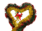 Heart of tinsel and Santa figurine — Stock Photo