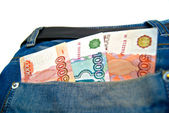 Money in a blue jeans pocket — Stockfoto