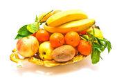 Fresh fruits on a platter on white — Zdjęcie stockowe