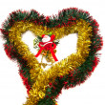 Tinsel heart and Santa figurine — Stock Photo