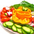 Royalty-Free Stock Photo: Fresh vegetables on a plate on white