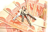 Banknotes and house keys — Stock Photo
