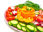 Fresh vegetables on a plate on white — Stock Photo