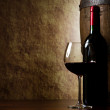 The still life with red wine, bottle, glass and old barrel — Stock Photo