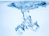 Blue water after ice cubes — Stock Photo