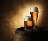 Still Life of beer and barrel on a old stone — Stock Photo