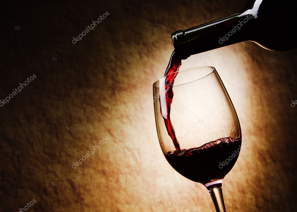 Red Wine glass and Bottle on a grange  Stock Photo #8351308