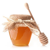 Honey with wood stick — Stock Photo