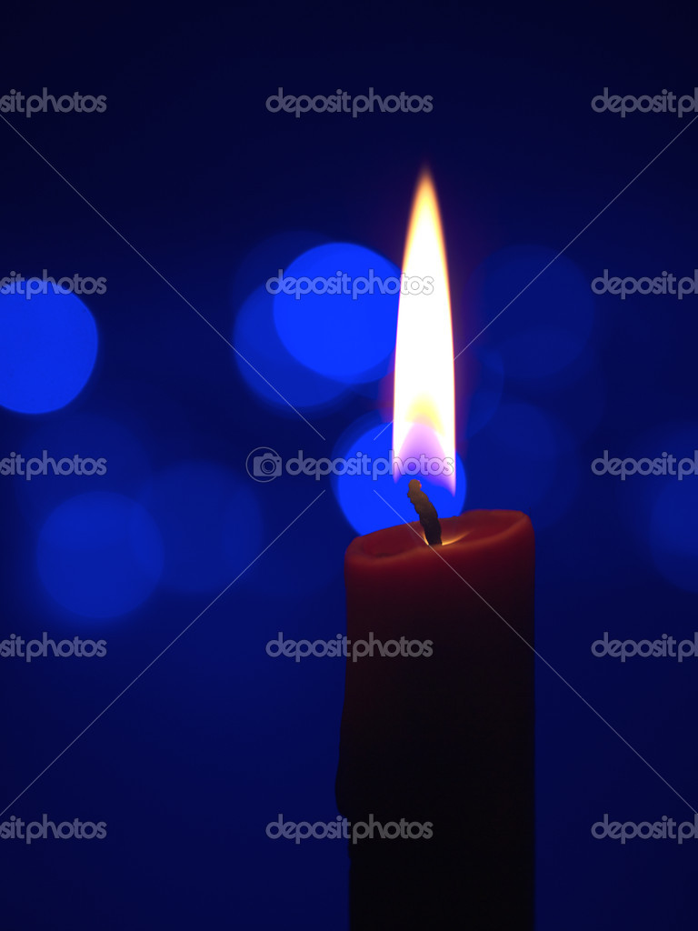 Burning candle with diffused highlights — Stock Photo #8509694