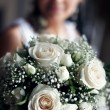 Young happy bride with flowers - Stock Photo