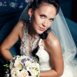 Young happy bride with flowers — Stock Photo #9234736