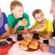 Stock Photo: Family eating at table