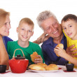 Family eating at table — Stock Photo