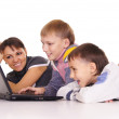 Mom and sons with laptop — Stock Photo #7963774