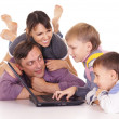 Family with computer — Stock Photo