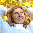Pretty old woman at park — Stock Photo #7964407