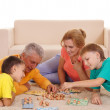 Family playing at carpet — Stock Photo #8005216