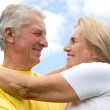 Old couple at sky — Stock Photo #8005821