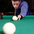 Man playing billiards — Stock Photo #8006103