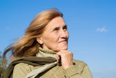 Old woman and sky — Stock Photo