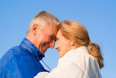 Cute aged couple at nature — Stock Photo