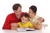 Nice family reading — Stock Photo