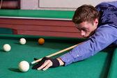 Guy playing billiards — Stock Photo