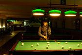 Man plays billiards — Stok fotoğraf