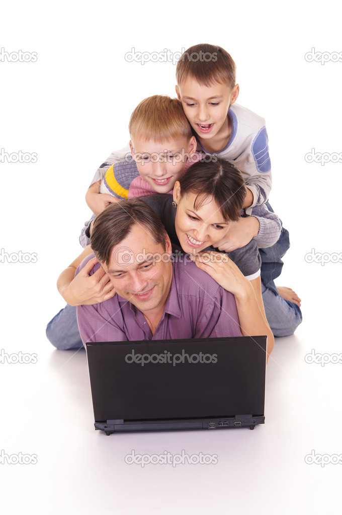 Cute family of a four with computer — Stock Photo #8005682