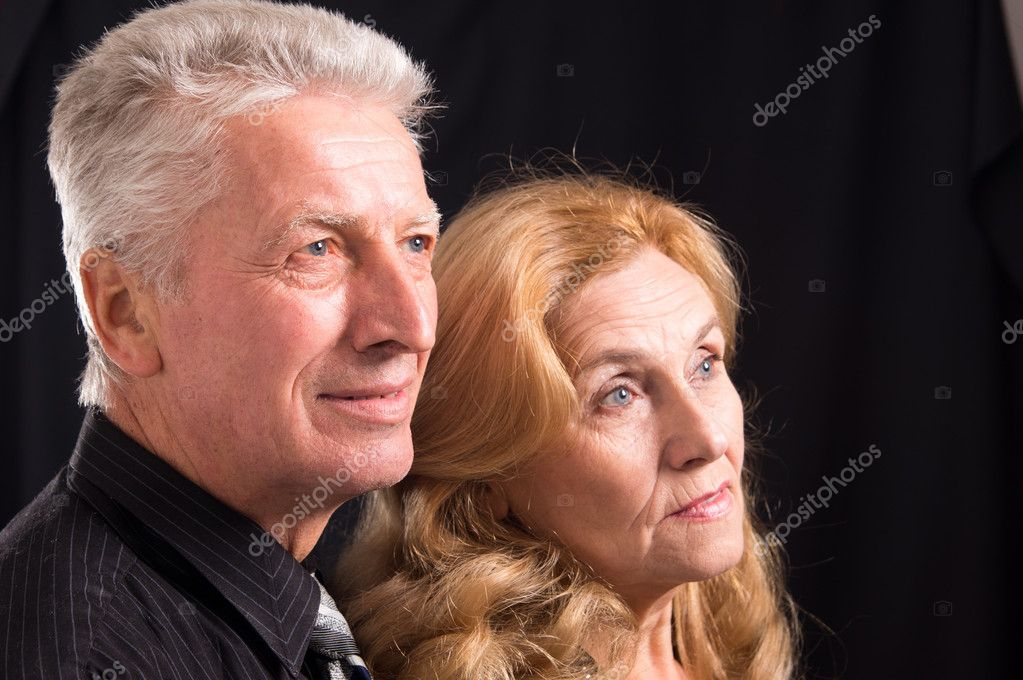 Cute od couple posing on a black  Lizenzfreies Foto #8005846