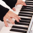 Fingers and piano keys — Stock Photo