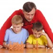 Stock Photo: Dad and sons playing