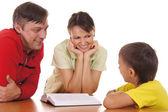 Happy family reading — Stock Photo