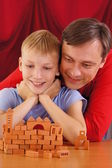 Dad and son on red — Stock Photo