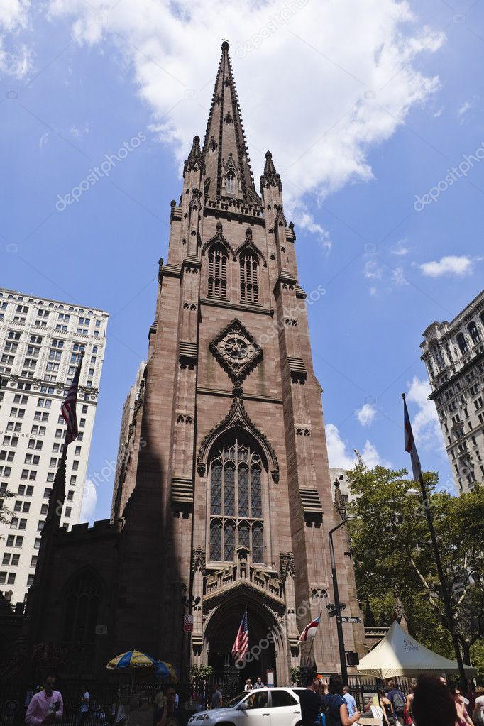 New york city, usa - july 18, 2010: trinity church at broadway and wall street in lower manhattan.  Stock Photo #9134745