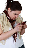 Young woman texting on smartphone — Stock Photo
