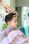 Lovely child at hairdresser — Stock Photo