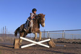 Young Girl Jumping Pony — Stock Photo