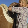 Girl Happy Saddles on Pony — Stock Photo