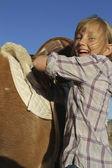 Girl Happy Saddles on Pony — Stock Photo