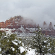 Stock Photo: Red Rock Landscape in Snowstorm