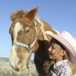 Happy Young Cowgirl and Pony — Stock Photo #9923725