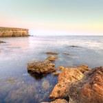 Sea landscape with orange stones — Stock Photo #8008064