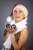 Girl with fur-tree toys in a white scarf — Stock Photo