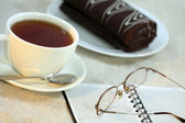 Cup of tea, the daily log, points and roll — Stock Photo