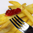 Plug and fried potato with sauce — Stockfoto