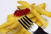 Plug and fried potato with sauce — Stock Photo