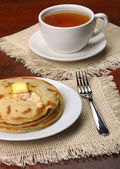 Breakfast from pancakes with tea — Stock Photo